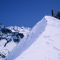 SKIING, Swiss Alps, Haute Route skiers atop Pigne d'Arolla.