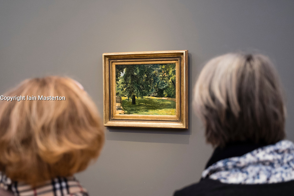 Visitor looking at painting, Garden Bench under the Chestnut Tree in the Wansee Garden, by Max Liebermann,     at new Museum Barberini in Potsdam Germany