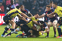Daniel Carpo (C) of Romania tries to stop Tai Tuisamoa (R) of USA during their  rugby test match between Romania and USA, on National Stadium Arc de Triomphe in Bucharest, November 8, 2014. Romania lose the match against USA, final score 17-27.