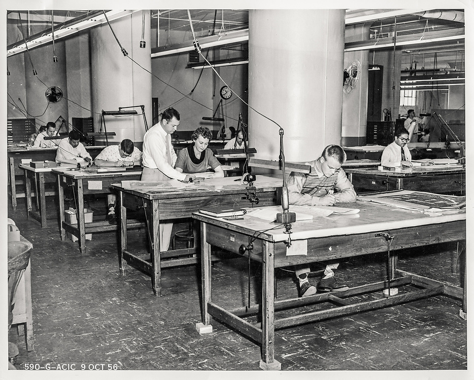 """Our dad, Harlan """"Buzz"""" Reese, foreground right, at work with colleagues at the Aeronautical Chart and Information Center in St. Louis, 1956.<br /> <br /> Photo courtesy Tom and Rob Reese"""