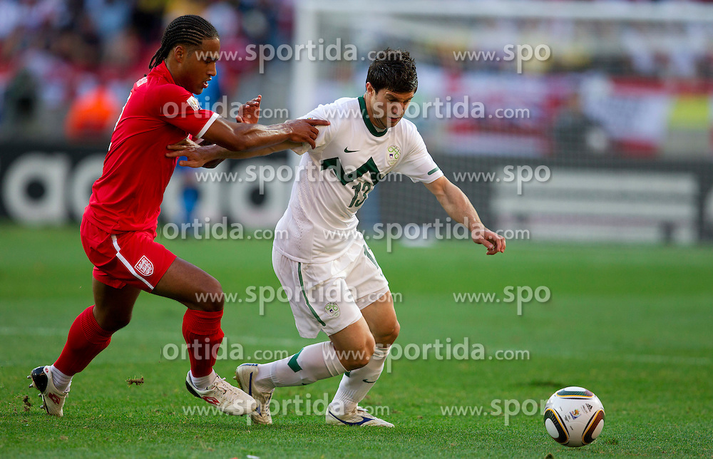 Glen Johnson of England vs Bojan Jokic of Slovenia during the 2010 FIFA World Cup South Africa Group C Third Round match between Slovenia and England on June 23, 2010 at Nelson Mandela Bay Stadium, Port Elizabeth, South Africa.  (Photo by Vid Ponikvar / Sportida)