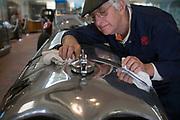 Mechanic Dave Nicholls cleans a Napier Railton car at the Brooklands Museum