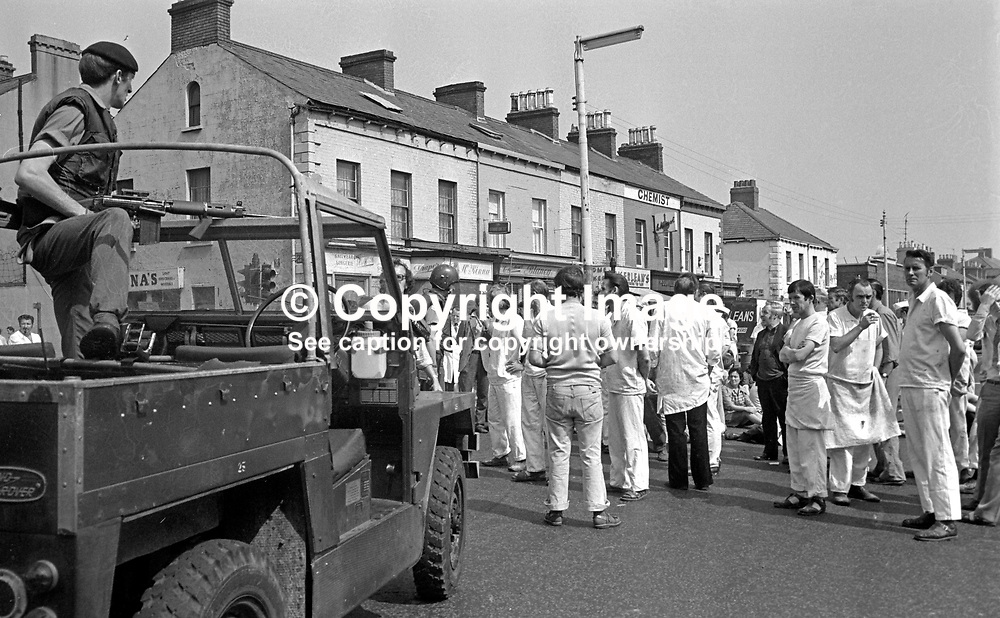 Angry bakery workers block the Springfield Road, Belfast, N Ireland, after the murder of company director, Charles Oliver Eaton, Protestant, who was shot by the Provisional IRA in the car park of the Peter Pan Bakery, on 30th June 1976. He died less than 30 minutes after the attack. A native of Londonderry he transferred to Belfast when his family's business amalgamated with the Bernard Hughes Bakery in Belfast to trade under the Peter Pan name. Mr Eaton was a member of the N Ireland Police Authority and a colonel in the Territorial Army. 197606300311COE3.<br /> <br /> Copyright Image from Victor Patterson, Belfast, UK<br /> <br /> t: +44 28 9066 1296 (from Rep of Ireland 048 9066 1296)<br /> m: +44 7802 353836<br /> e: victorpattersonbelfast@gmail.com<br /> <br /> www.images4media.com<br /> <br /> Please see my full Terms and Conditions of Use at https://www.images4media.com/p/terms-conditions - it is IMPORTANT that you familiarise yourself with them.<br /> <br /> Images used online incur an additional cost. This cost should be agreed in writing in advance. Online images must be visibly watermarked i.e. © Victor Patterson or that of the named photographer within the body of the image. The original metadata must not be deleted from images used online.<br /> <br /> This image is only available for the use of the download recipient i.e. television station, newspaper, magazine, book publisher, etc, and must not be passed on to a third party. It is also downloaded on condition that each and every usage is notified within 7 days to victorpattersonbelfast@gmail.com.<br /> <br /> The right of Victor Patterson (or the named photographer) to be identified as the author is asserted in accordance with The Copyright Designs And Patents Act (1988). All moral rights are asserted.