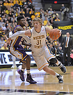 WICHITA, KS - JANUARY 05:  Guard Ron Baker #31 of the Wichita State Shockers drives by guard Wes Washpun #11 of the Northern Iowa Panthers during the first half on January 5, 2014 at Charles Koch Arena in Wichita, Kansas.  (Photo by Peter G. Aiken/Getty Images) *** Local Caption *** Ron Baker;Wes Washpun