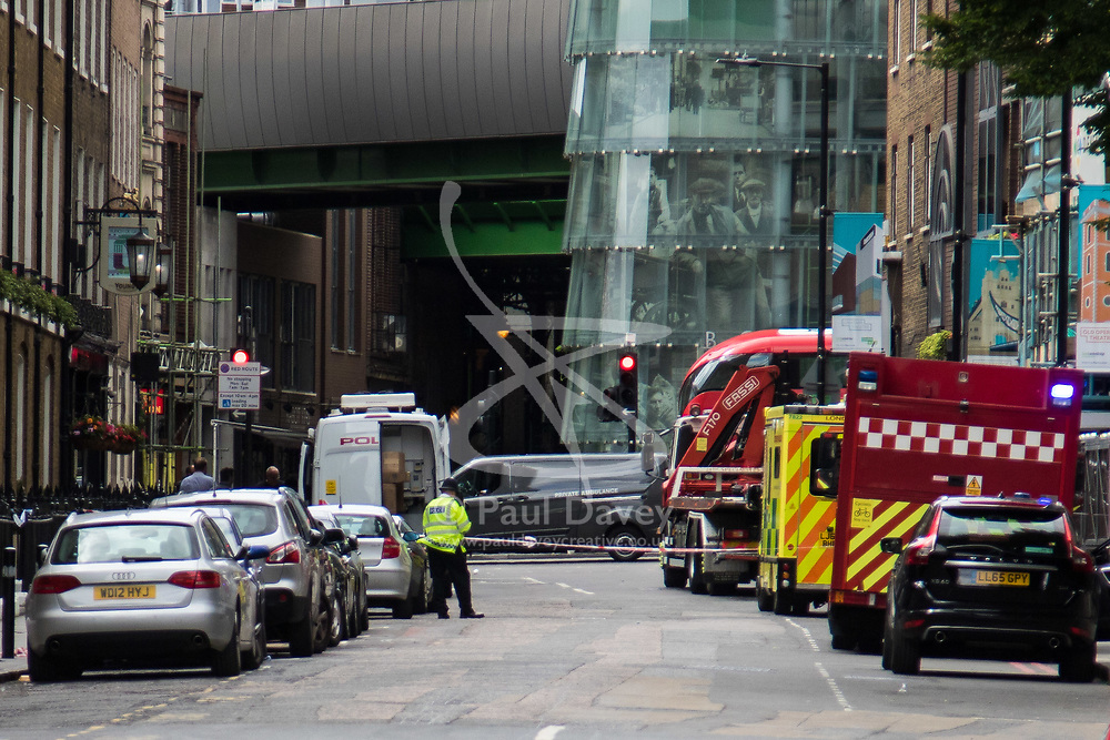 London, June 4th 2017. A private ambulance containing the body leaves the scene during a massive policing operation in the aftermath of the terror attack on London Bridge and Borough Market on the night of June 3rd which left seven people dead and dozens injured