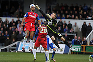 Bristol Rovers keeper Steve Mildenhall punches clear from Gillingham's Leon Legge (l) and Deon Burton (20).  NPower league two match, Bristol Rovers v Gillingham at the Memorial stadium in Bristol on Saturday 5th Jan 2013. pic by Andrew Orchard, Andrew Orchard sports photography,
