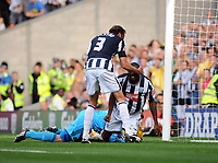 The Hawthorns West Bromwich Albion v Newcastle United Championship 08/08/2009<br /> Shelton Martis (West Bromwich Albion) celebrates first goal  with Jonas Olsson as  Newcastle 'keeper Steve Harper lies injured after collision with his own defender<br /> Photo Roger Parker Fotosports International