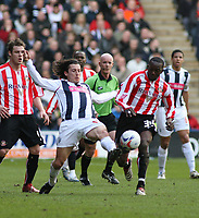Photo: Mark Stephenson.<br />West Bromwich Albion v Sunderland. Coca Cola Championship. 03/03/2007. West Brom's Robert Koren wins the ball