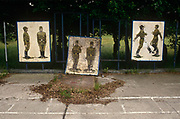 Old Soviet parade ground murals show the physical style of Russian marching techniques in the former Russian Soviet army camp in occupied East Germany ex-GDR/DDR, on 16th June 19990, on Halb Insel Wustrow, near Rostock, Germany. Wustrow was once a WW2 German anti-aircraft artillery position then housing civilian refugees before the eventual Soviet occupation of the former DDR during the Cold War, up until 1990 and the fall of communism and the Berlin Wall. The camp was ransacked and all its assets stripped before its desertion that summer and is a reminder of a fallen ideology.