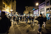 OAKLAND, CA - OCTOBER 26, 2011: Occupy Oakland protesters march down Telegraph Street, passing the Fox Theater as they make their way back to their encampment at Frank H. Ogawa Plaza.