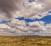 A portable toilet sits in a field in the grasslands north of Sonoita, Arizona, USA.