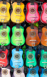 collection of colorful wooden toy guitars