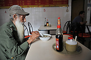 China Out - Finland Out <br /> <br /> 93-Year-Old Veteran Works As Nude Model In Guangzhou<br /> <br /> Jisheng, 93-year-old nude veteran model, enjoys his favorite Wonton in a small restaurant on October 21, 2013 in Guangzhou, Guandong Province of China. Li participated in the Korean War (1950-53) and left his hometown, a small village in Hennan Province, in 1995 to go to Guangzhou to find a job to support himself. He was lucky to spot an art teacher and became a model for painting class since then on.<br /> ©Exclusivepix