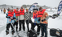 """The """"Backyard Ice"""" team (Shinny 35+ division)  arrives with a sense of humor and their life jackets for their first game with the HFD Flatlanders during day one of the New England Pond Hockey Classic on Lake Waukewan Friday.  (l-r) Chet Warsheski, Chris Davison, Brent Squires, Andy Johnson, Alex Rogo and Tim Davison.  (Karen Bobotas/for the Laconia Daily Sun)"""
