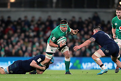 Ireland's CJ Stander (centre) is tackled by Scotland's Rory Sutherland and Scott Cummings during the Guinness Six Nations match at the Aviva Stadium, Dublin.