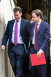 Downing Street, London, April 12th 2016. Chief Secretary to the Treasury Greg Hands (Right) is followed by Attorney General Jeremy Wright as they leave the weekly cabinet meeting. <br /> ©Paul Davey<br /> FOR LICENCING CONTACT: Paul Davey +44 (0) 7966 016 296 paul@pauldaveycreative.co.uk