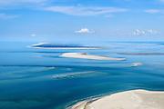 Nederland, Friesland, Ameland, 05-08-2014;  Schiermonnikoog gezien vanaf Ameland. Tussen de eilanden het Friese zeegat met in de Waddenzee de zandplaten Het Rif en Engelmansplaat (rechts). <br /> Wadden island Schiermonnikoog, Wadden sea.<br /> luchtfoto (toeslag op standard tarieven);<br /> aerial photo (additional fee required);<br /> copyright foto/photo Siebe Swart