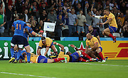 Valentin Ursache (Romania) scoring a Romanian try and the team celebrating during the Rugby World Cup Pool D match between France and Romania at the Queen Elizabeth II Olympic Park, London, United Kingdom on 23 September 2015. Photo by Matthew Redman.