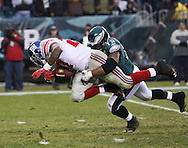 PHILADELPHIA - DECEMBER 9: Juqua Thomas #75 of the Philadelphia Eagles brings down the ball carrier from the New York Giants during the game on December 9, 2007 at Lincoln Financial Field in Philadelphia, Pennsylvania. The Giants won 16-13.
