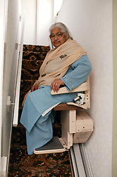 South Asian lady using a stair lift,