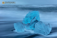 Diamond ice chards from calving icebergs on black sand beach at Jokulsarlon in south Iceland