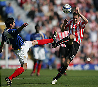 Photo: Lee Earle.<br /> Portsmouth v Sunderland. The Barclays Premiership. 22/04/2006. Pompey's Richard Hughes (L) clashes with Tommy Miller.