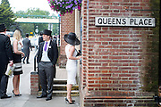© Licensed to London News Pictures. 19/06/2014. Ascot, UK. A woman uses a cashpoint.  Day three, Ladies Day, at Royal Ascot 19th June 2014. Royal Ascot has established itself as a national institution and the centrepiece of the British social calendar as well as being a stage for the best racehorses in the world. Photo credit : Stephen Simpson/LNP