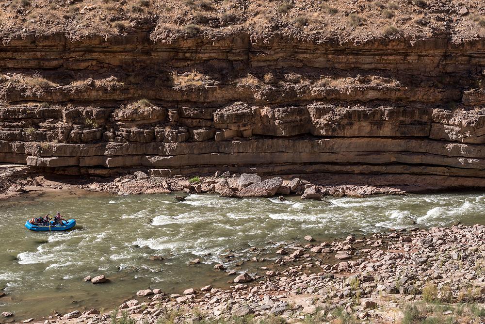 Running Ross Rapid on Utah's San Juan River in a raft.