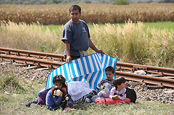 © London News Pictures. © London News Pictures. Migrants are seen close to the Hungarian and Serbian border town of Roszke, Hungary, September 7 2015. The UN's humanitarian agencies are on the verge of bankruptcy and unable to meet the basic needs of millions of people because of the size of the refugee crisis in the Middle East, Africa and Europe, senior figures within the UN have told the media.   Picture by Paul Hackett /LNP