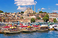 The Suleymaniye Mosque (Süleymaniye Camii, 1550-1558)  on the Third Hill and boats selling cooked fish on the banks of the Golden Horn, Istanbul Turkey. .<br /> <br /> If you prefer to buy from our ALAMY PHOTO LIBRARY  Collection visit : https://www.alamy.com/portfolio/paul-williams-funkystock/istanbul.html<br /> <br /> Visit our TURKEY PHOTO COLLECTIONS for more photos to download or buy as wall art prints https://funkystock.photoshelter.com/gallery-collection/3f-Pictures-of-Turkey-Turkey-Photos-Images-Fotos/C0000U.hJWkZxAbg