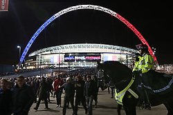 © Licensed to London News Pictures. 18/11/2015. London, UK. Mounted police keep watch as the crowd leaves Wembley stadium after the England v France football match. Photo credit: Peter Macdiarmid/LNP