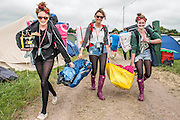 Sunday morning and people are begining to leave. The 2013 Glastonbury Festival, Worthy Farm, Glastonbury. 30 June 2013. © Guy Bell, guy@gbphotos.com, all rights reserved