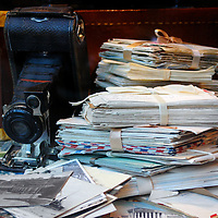 Camera, postcards, and letters