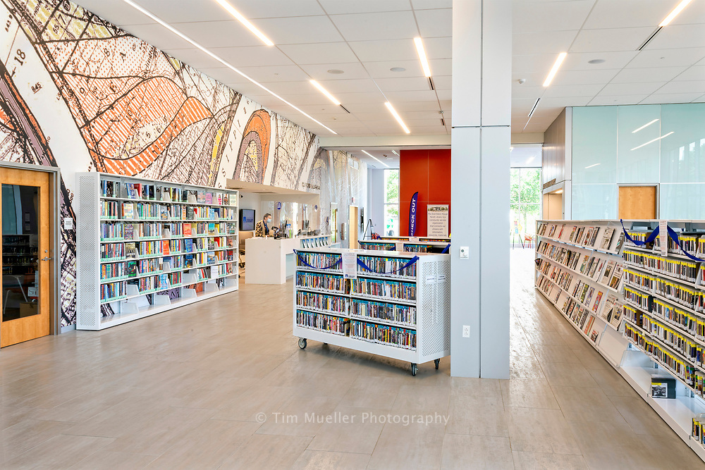 The new 48,316 square foot River Center Branch Library overlooks North Boulevard Town Square in Baton Rouge, La. The first-floor welcome area has a large mural of a historic view of the Mississippi River as it passes Baton Rouge. The mural dates from 1944 and was published by the Army Corp of Engineers; drawn by Howard Fisk. The welcome area includes a laptop bar and public computers.