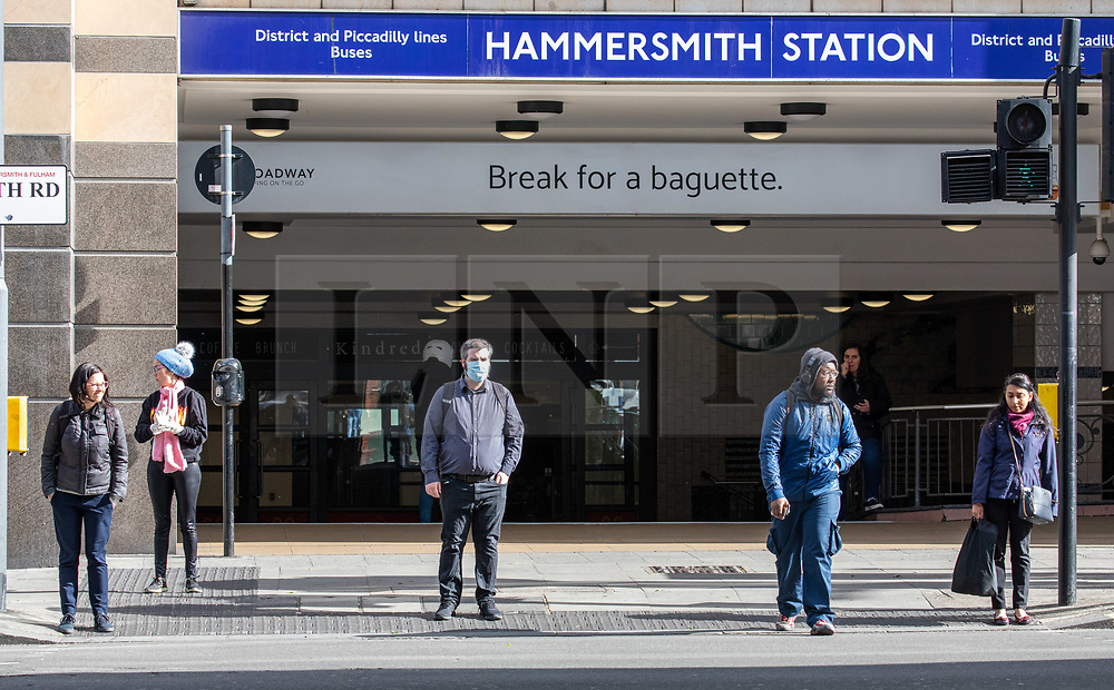 © Licensed to London News Pictures. 11/05/2020 8.30am. London, UK. Commuters social distance at Hammersmith Station while heading back to work this morning as Prime Minister Boris Johnson called for workers who can't work from home to go back to work where possible in his address to the Nation on Sunday on easing the current lockdown situation. Photo credit: Alex Lentati/LNP