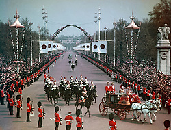 Coach returns to Buckingham Palace from The Mall after the wedding of Princess Margaret to the Earl of Snowdon at Westminster Abbey.