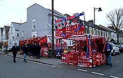 A general view of street vendors selling match related merchandise prior to the beginning of the Premier League Match at Emirates Stadium
