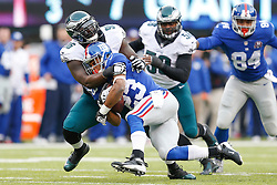 Philadelphia Eagles nose tackle Bennie Logan #96 tackles New York Giants running back Rashad Jennings #23 during the NFL game between the Philadelphia Eagles and the New York Giants at MetLife Stadium in East Rutherford, New Jersey on Sunday, December 24th 2014. The Eagles won 34-26. (Brian Garfinkel/Philadelphia Eagles)