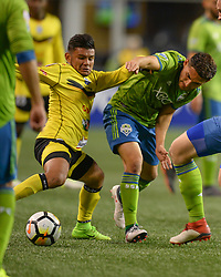 March 1, 2018 - Seattle, Washington, U.S - Soccer 2018: WILMA TORRES (21) and CRISTIAN ROLDAN (7) fight for possession during a CONCACAF match between Santa Tecla and the Seattle Sounders at Century Link Field in Seattle, WA. (Credit Image: © Jeff Halstead via ZUMA Wire)