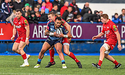 Cardiff Blues' Willis Halaholo is tackled by Scarlets' Hadleigh Parkes - Mandatory by-line: Craig Thomas/Replay images - 31/12/2017 - RUGBY - Cardiff Arms Park - Cardiff , Wales - Blues v Scarlets - Guinness Pro 14