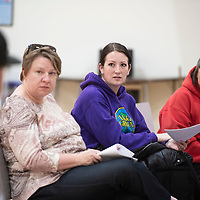 Left to right, Amy Jo Mulvaney, Katy Lee and Denise Kettering speak up during City Councilor Fran Palochak's  neighborhood Thursday, April 11 at Tobe Turpen Elementary School.