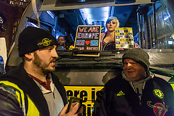 "A pro-Remain campaigner aboard the ""Bollocks to Brexit"" Bus looks on as Pro-Brexit campaigner James Goddard in his 'gilet juane' attempts to stop its arrival at at Steve Bray's  ongoing SODEM pro-remain protest at Old Palace Yard outside Parliament. Westminster, London, December 20 2018."