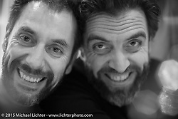Art director Jean-Louis Theuil and Fabrice Roux, the publisher of Freeway France and Moto Heroes Magazines in Francer, at dinner during EICMA, the largest international motorcycle exhibition in the world. Milan, Italy. November 18, 2015.  Photography ©2015 Michael Lichter.