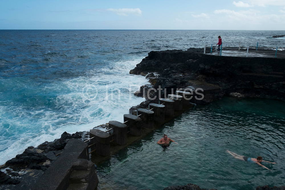 Tidal pools which allow swimming while being protected from powerful sea and crashing waves at Charco Azul in La Palma, Canary Islands, Spain. La Palma, also San Miguel de La Palma, is the most north-westerly Canary Island in Spain. La Palma has an area of 706km2 making it the fifth largest of the seven main Canary Islands.