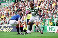 Stilian Petrov (Celtic) Barry Ferguson (Rangers). Celtic 6:2 Rangers, Scottish Premier League, Celtic Park, Glasgow, Scotland, 27/8/2000. Credit Colorsport: Stuart MacFarlane.