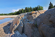 Rocky shoreline of Lake Superior at Prisoners Cove<br /> Neys Provincial Park<br /> Ontario<br /> Canada