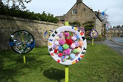 © Licensed to London News Pictures. 29/04/2016. Pateley Bridge, UK. Residents in the North Yorkshire village of Ripley have decorated bike wheels and displayed them along the route of the 2016 Tour De Yorkshire. The three-day road cycling race held annually across Yorkshire is in it's second year. Photo credit : Ian Hinchliffe/LNP