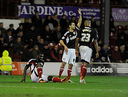 Bristol City's Karleigh Osborne picks up an injury after scoring - Photo mandatory by-line: Dougie Allward/JMP - Tel: Mobile: 07966 386802 28/01/2014 - SPORT - FOOTBALL - Griffin Park - Brentford - Brentford v Bristol City - Sky Bet League One