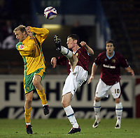 Photo: Paul Thomas.<br /> Burnley v Norwich City. Coca Cola Championship. 23/10/2007.<br /> <br /> Luke Chadwick (L) of Norwich shields himself from a Chris McCann kick.