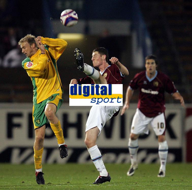 Photo: Paul Thomas.<br /> Burnley v Norwich City. Coca Cola Championship. 23/10/2007.<br /> <br /> Luke Chadwick (L) of Norwich shields himself from a Chris McCann kick.
